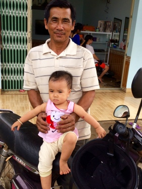 "Man and is granddaughter in ""noodle village"""